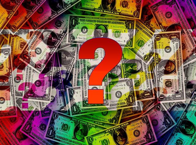 dolarové bankovky a otazník